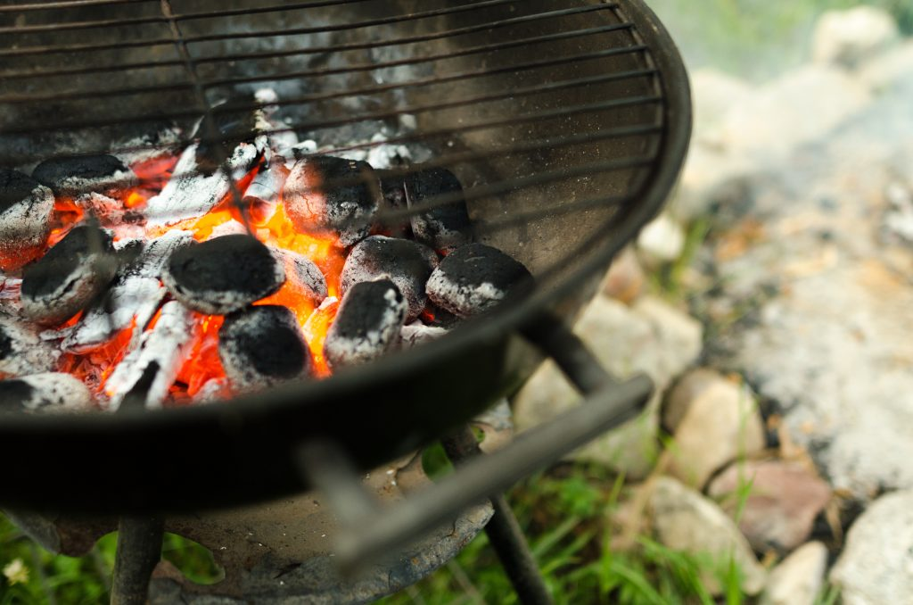 close up shot of burning coals on a grill