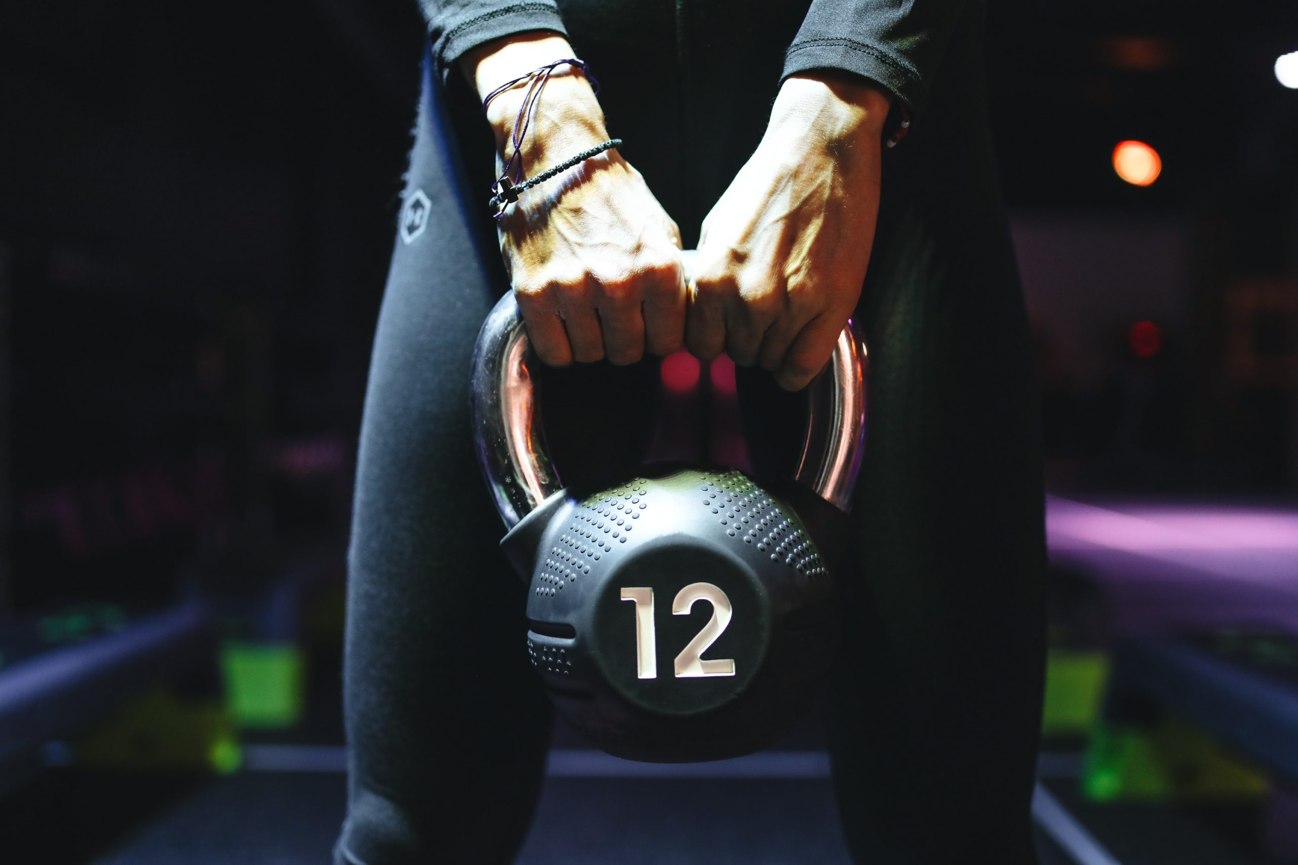 person-holding-kettlebell-3875385