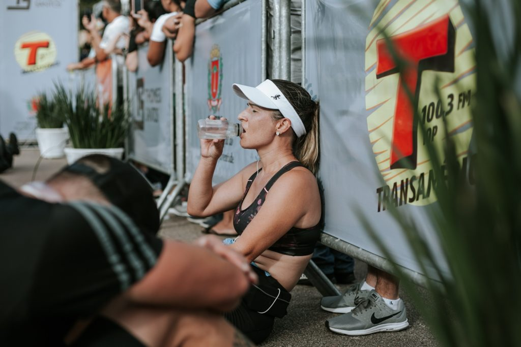Runner sitting down drinking water