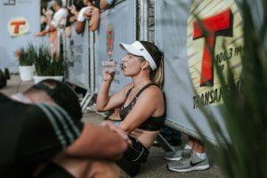 Runner sitting down drinking water
